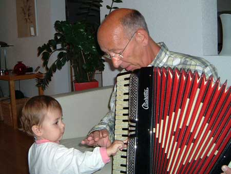 Berit learns how to play the accordion